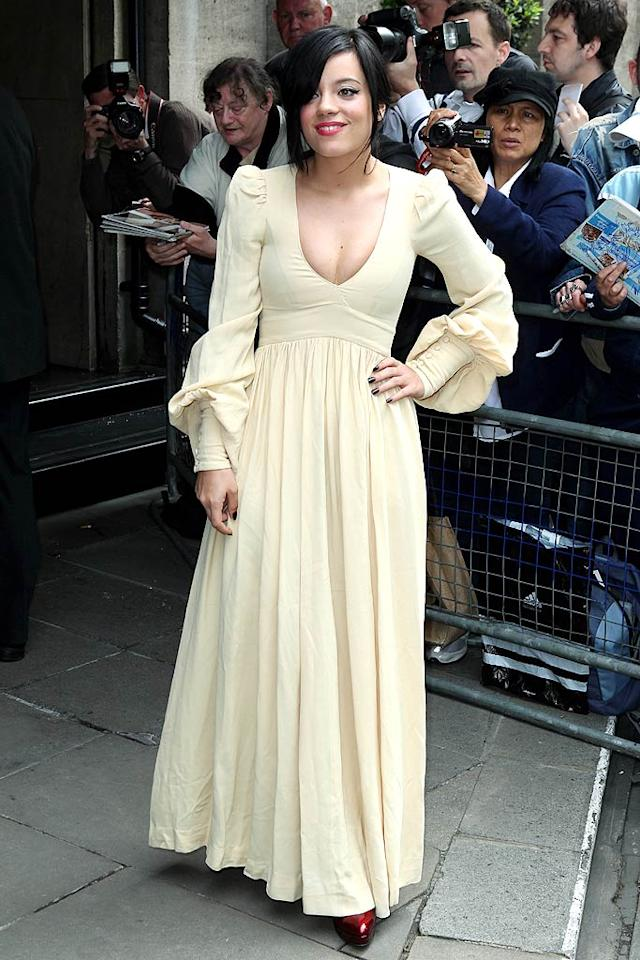"Hey, at least Taylor didn't look as ridiculous/Ren fair-ready as Lily Allen did at the 2010 Ivor Novello Awards in London. Ian Lawrence/<a href=""http://www.splashnewsonline.com"" target=""new"">Splash News</a> - May 20, 2010"