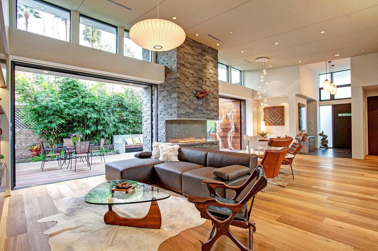 """<p>Seamless indoor/outdoor living is a centuries-old ideal that crosses many different cultures. When you blur the transition between home and garden, you allow natural light and air to permeate your living space, changing its character entirely. In this open-concept living area by <a href=""""http://bit.ly/1KSVCrF"""">Jackson Design and Remodeling</a>, the Zen garden and the living room are separated only by massive glass doors on a track that can open and close with the push of a button. (Photo by Jackson Design and Remodeling)<br /></p>"""