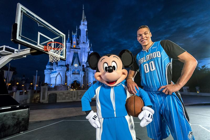 Aaron Gordon poses with an undersized forward in front of a castle. (Matt Stroshane/Walt Disney World)