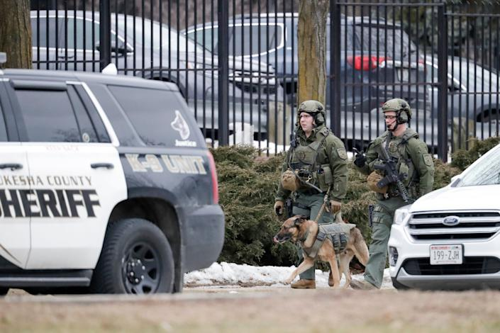 Police conduct searches outside the Molson Coors campus in Milwaukee on Wednesday after reports of a possible shooting. (Photo: Morry Gash/ASSOCIATED PRESS)