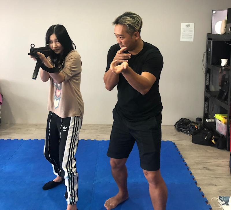 Red Dot Artists actress Ferlyn Wong training for an upcoming role as an elite military recruit. (Red Dot Artists)