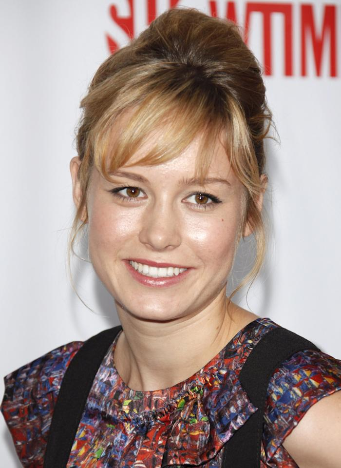 <p>Arriving at the 2009 TCA Summer Tour, Larson wore her hair in a tousled up do with swept over bangs, and kept her makeup natural and dewey with a hint of lip gloss and highlighter.</p>