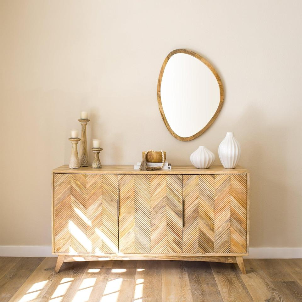 <p>Place this sleek <span>Foundry Select Desborough Safie Rustic Accent Mirror</span> ($167, originally $185) above your credenza.</p>