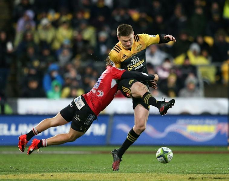Beauden Barrett of the Wellington Hurricanes (R) is tackled by Faf de Klerk of the Lions of South Africa during their Super Rugby match, at Westpac Stadium in Wellington, in August 2016