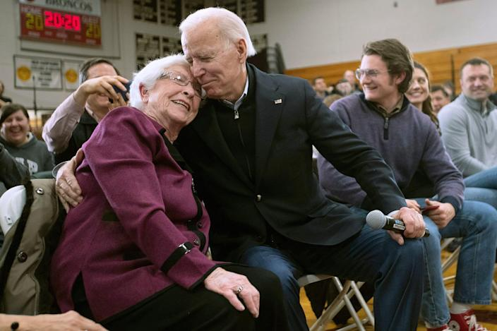 President-elect Joe Biden, then a presidential candidate, hugs a supporter during a campaign rally Feb. 9, 2020, in Hudson, New Hampshire.