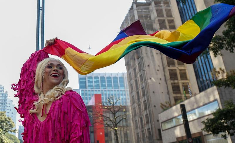 "A drag queen takes part in the 23rd Gay Pride Parade in Sao Paulo, Brazil, paying tribute to ""50 Years Since Stonewall,"" a nod to protests at a New York gay bar in 1969 that helped launch the modern LGBT rights movement (AFP Photo/Miguel SCHINCARIOL)"