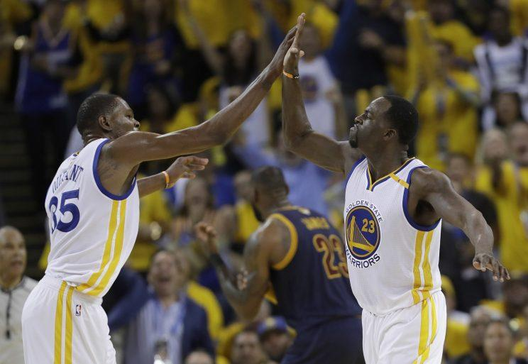 Draymond Green celebrates the fruits of his late-night phone calls with Kevin Durant. (AP)