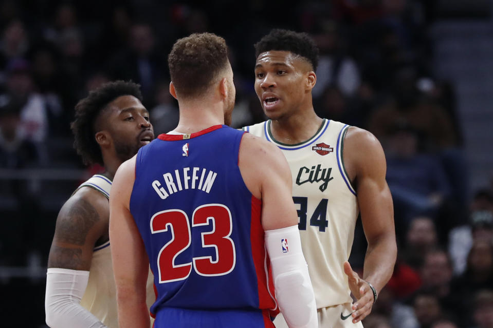 Detroit Pistons forward Blake Griffin (23) and Milwaukee Bucks forward Giannis Antetokounmpo (34) exchange words after a foul on the floor during the first half of an NBA basketball game, Wednesday, Dec. 4, 2019, in Detroit. (AP Photo/Carlos Osorio)