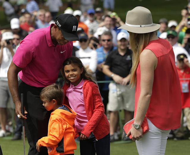 Lindsey Vonn watches as Tiger Woods hugs his children Charlie, left and Sam during a practice round for the Masters golf tournament Tuesday, April 7, 2015, in Augusta, Ga. (AP Photo/Chris Carlson)