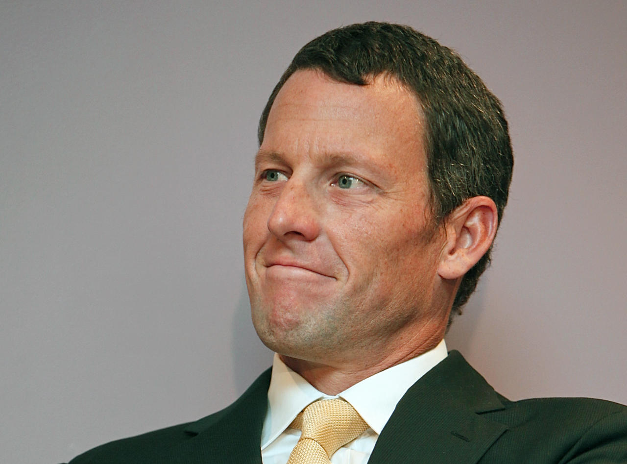 FILE - In this Feb. 28, 2011, file photo, former cycling champion Lance Armstrong smiles during a news conference at the Cedars-Sinai Hospital in Los Angeles. The U.S. Anti-Doping Agency on Wednesday, July 11, 2012, granted Armstrong an extension of up to 30 days to contest drug charges while the seven-time Tour de France winner challenges the case in federal court. (AP Photo/Damian Dovarganes, File)
