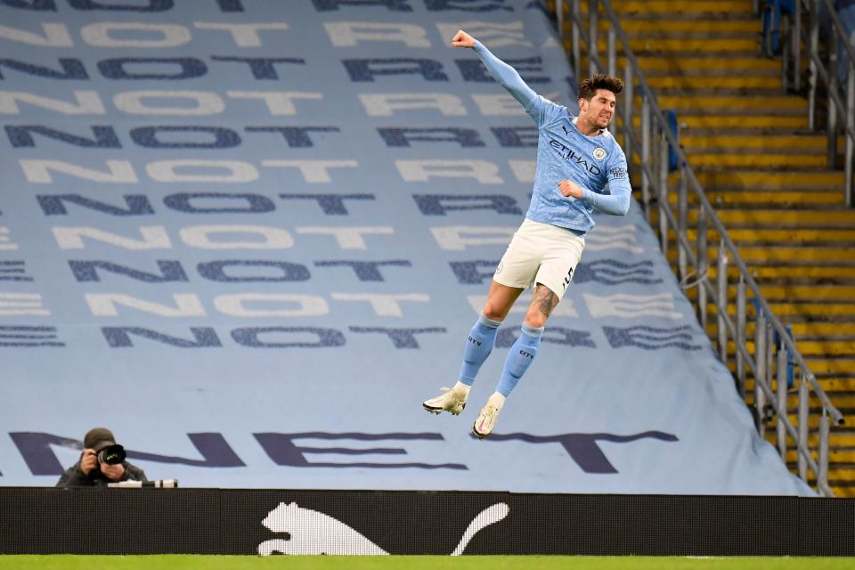 John Stones netted a brace, the first goal marking his first in the league for CityPOOL/AFP via Getty Images