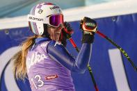 Italy's Marta Bassino celebrates at the end of an alpine ski, women's World Cup super-G in St. Anton, Austria, Sunday, Jan.10, 2021. (AP Photo/Giovanni Auletta)
