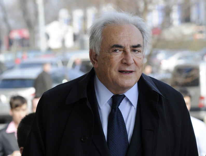 FILE - In this April 4, 2012 photo, former International Monetary Fund leader, Dominique Strauss-Kahn enters a building prior to his lecture in the Ukrainian Diplomatic Academy in Kiev, Ukraine. A person familiar with the case says the former International Monetary Fund chief and a New York City hotel maid who accused him of trying to rape her have reached an agreement to settle her lawsuit. The deal would end a legal saga that forced Strauss-Kahn's resignation as head of the IMF and ended his French presidential ambitions in 2011. (AP Photo/Sergei Chuzavkov)