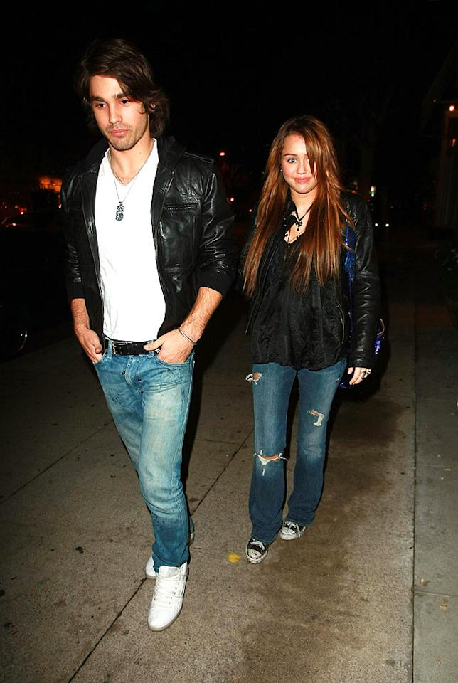 """16-year-old Miley Cyrus and 20-year-old Justin Gaston played coy after leaving Koi restaurant in Los Angeles Thursday night. Miley revealed in a YouTube video that she still loves her ex Nick Jonas, whom she performed with at an inauguration concert earlier in the week. Miley also denied feuding with fellow teen stars Demi Lovato and Selena Gomez. <a href=""""http://www.infdaily.com"""" target=""""new"""">INFDaily.com</a> - January 22, 2009"""