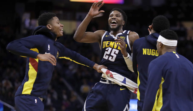 Denver Nuggets' Malik Beasley celebrates a score against the Golden State Warriors during the second half of an NBA basketball game Thursday, Jan. 16, 2020, in San Francisco. (AP Photo/Ben Margot)
