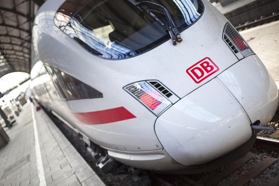 An ICE train waiting for its departure at main station Wiesbaden, Germany. ICE, formerly known as InterCityExpress is a highspeed train system in Germany. The pictured train connects the cities Wiesbaden in the west and Leipzig in the East of Germany. Deutsche Bahn AG (DB) is a national railway company in Germany and headquartered in Berlin. DB is the successor to the former state railways of Germany (Deutsche Bundesbahn)