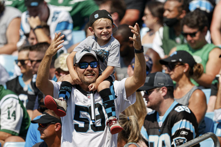 Carolina Panthers fans cheer during the second half of an NFL football game against the New York Jets on Sunday, Sept. 12, 2021, in Charlotte, N.C. (AP Photo/Nell Redmond)