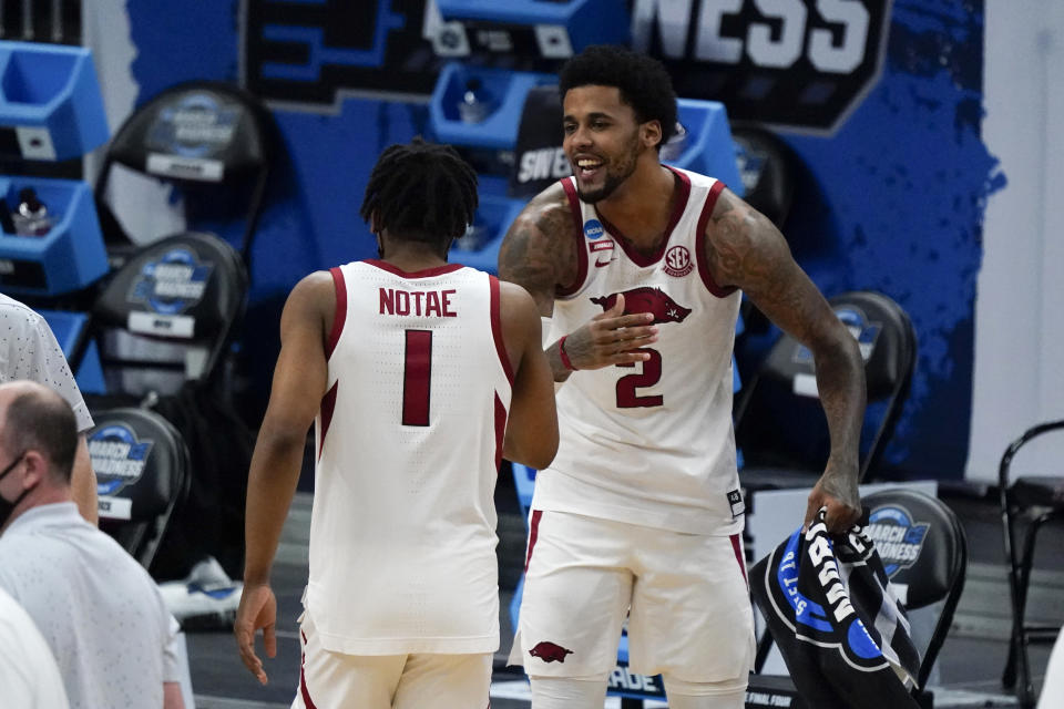 Arkansas forward Vance Jackson (2) celebrates with teammate guard JD Notae (1) after a Sweet 16 game against Oral Roberts in the NCAA men's college basketball tournament at Bankers Life Fieldhouse, Saturday, March 27, 2021, in Indianapolis. Arkansas won 72-70. (AP Photo/Jeff Roberson)