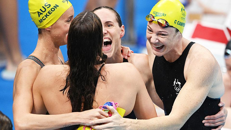 Australia's 4x100m relay team, pictured here celebrating their gold medal and world record.