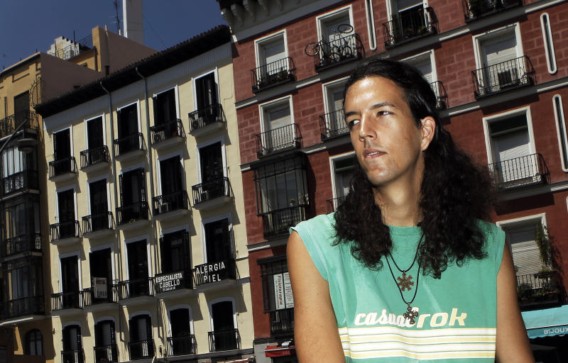 FOR STORY : CLASS OF 2012 - BRAIN DRAIN : Santiago Oviedo poses for a picture at Tirso de Molina square in Madrid, Spain, Sunday, July 29, 2012. Santiago Oviedo, a tall 24-year old from Madrid, is on track to get his master's in physics in October 2012, a crucial milestone in his dream of becoming a researcher probing the origins of the universe, but Spain won't benefit from his big brain, because of education spending cuts and Spain's downward economic spiral, Oviedo is planning to emigrate to Britain, France, the Netherlands or Germany to get his Ph.D. or work at a company that lets him do research. He's afraid he may never work or raise a family in his country.  (AP Photo/Andres Kudacki)