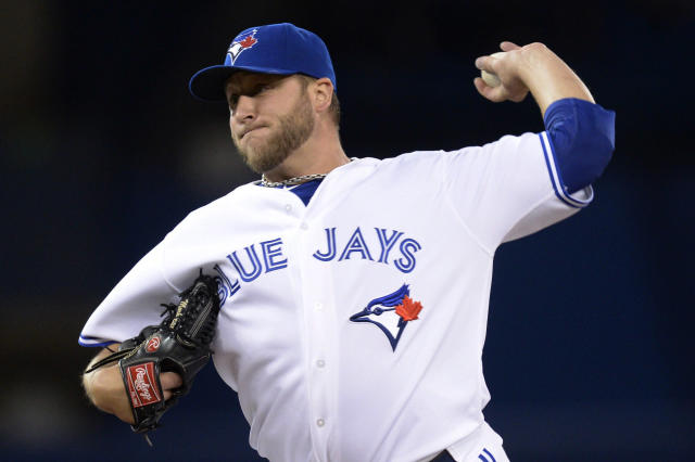 Toronto Blue Jays starting pitcher Mark Buehrle throws to the Boston Red Sox during the first inning of a baseball game in Toronto on Friday, April 25, 2014. (AP Photo/The Canadian Press, Frank Gunn)