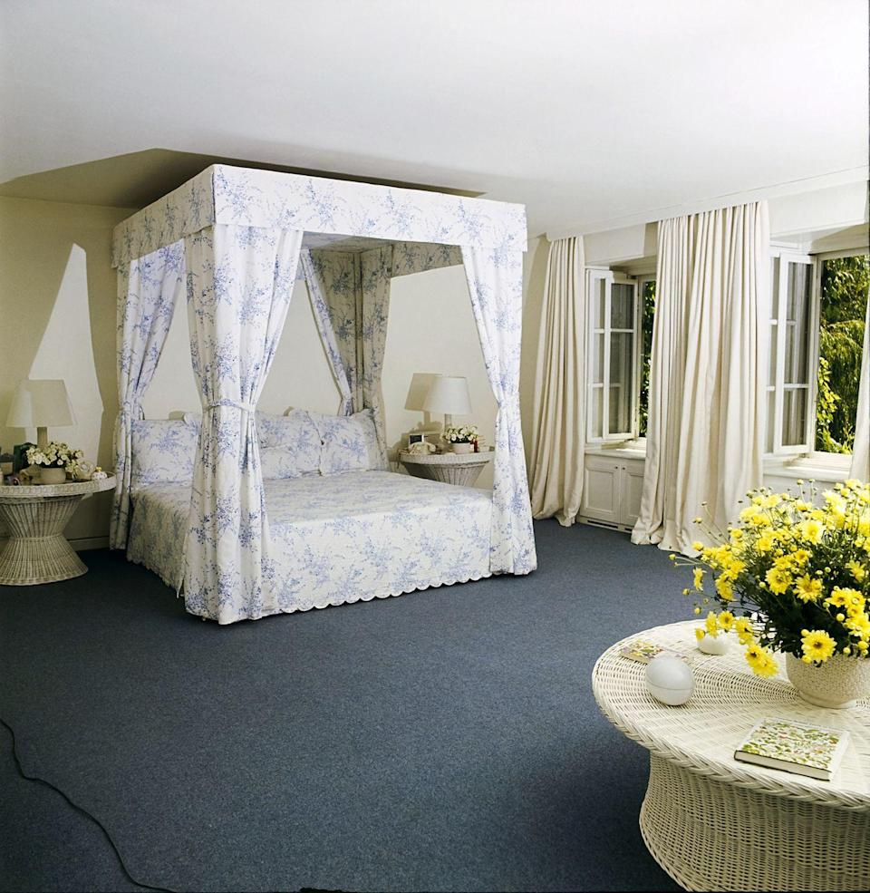 <p>The interior of Audrey Hepburn's home is as beautiful as you'd imagine, with fresh white tones and pops of pastel colors. The bedroom had a canopy bed fitted in a light blue toile fabric. </p>