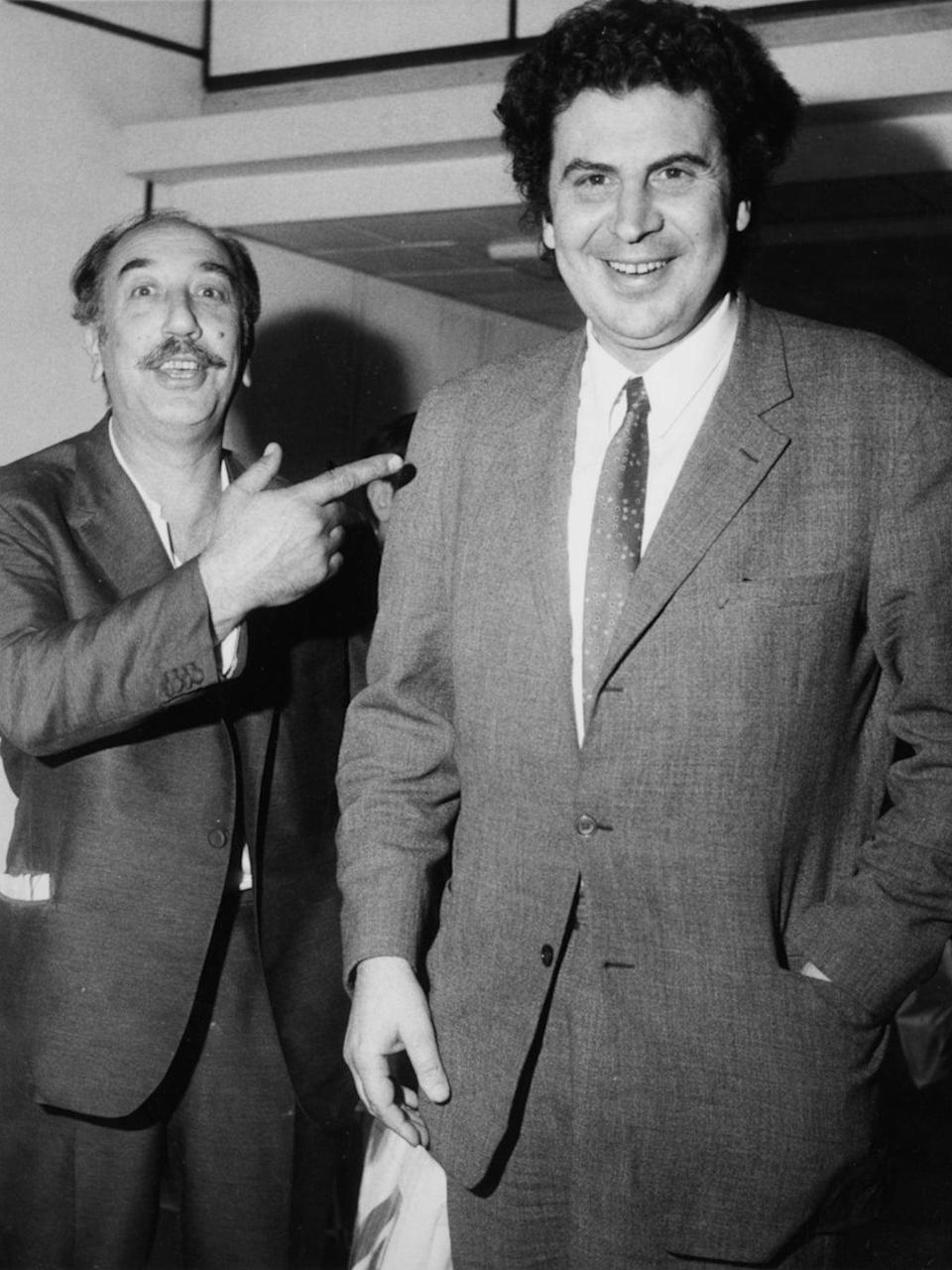 Theodorakis (right) arrives in the UK in 1970 (Getty)