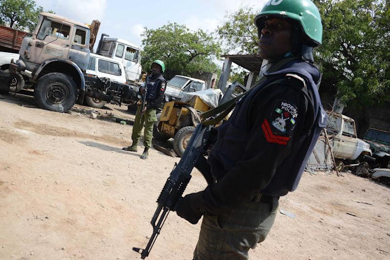 Somali federal government forces and African Union peacekeepers patrol a street in Mogadishu on July 27, 2014