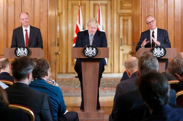 <strong>Prime minister Boris Johnson flanked by the UK's chief medical adviser Chris Whitty (left) and the chief scientific adviser Patrick Vallance on March 3, 2020.</strong> (Photo: FRANK AUGSTEIN via Getty Images)