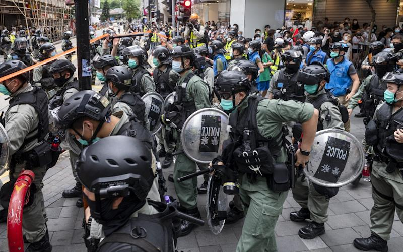 Riot police officers going through clearance operation during a protest in Causeway Bay - Anadolu