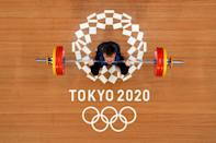 <p>TOKYO, JAPAN - JULY 25: Igor Son of Team kazakhstan competes during the Weightlifting - Men's 61kg Group A on day two of the Tokyo 2020 Olympic Games at Tokyo International Forum on July 25, 2021 in Tokyo, Japan. (Photo by Chris Graythen/Getty Images)</p>