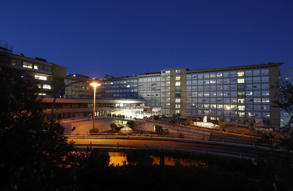A nocturnal view of Rome's Gemelli Polyclinic where Pope Francis was hospitalized in the afternoon for a scheduled surgery for a stenosis, or restriction, of the large intestine, Sunday, July 4, 2021. The news came just three hours after Francis had cheerfully greeted the public in St. Peter's Square and told them he will go to Hungary and Slovakia in September. (AP Photo/Riccardo De Luca)