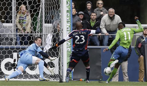 New England Revolution goalkeeper Bobby Shuttleworth, left, and Jose Goncalves (23) defend against a close-range shot by Seattle Sounders's Steve Zakuani (11) in the first half of an MLS soccer match on Saturday, April 13, 2013, in Seattle. (AP Photo/Ted S. Warren)