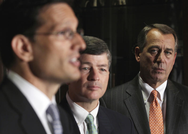 House Speaker John Boehner of Ohio, right, and Republican Conference Chairman Rep. Jeb Hensarling, R-Texas , center, listen as  House Majority Leader Eric Cantor of Va., left, speaks during a news conference at The Republican National Committee on Capitol Hill in Washington, Tuesday, July 26, 2011. (AP Photo/Carolyn Kaster)