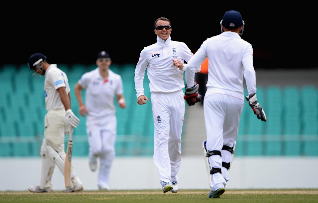SYDNEY, AUSTRALIA - NOVEMBER 16:  Graeme Swann of England celebrates dismissing Ryan Carters of CA Invitational XI during day four of the tour match between CA Invitational XI and England at the Sydney Cricket Ground on November 16, 2013 in Sydney, Australia.  (Photo by Gareth Copley/Getty Images)