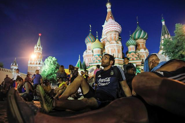 Fans from Argentina watch a soccer game near Red Square in Moscow June 16, 2018. As well as shooting all the matches, Reuters photographers are producing pictures showing their own quirky view from the sidelines of the World Cup. REUTERS/Maxim Shemetov