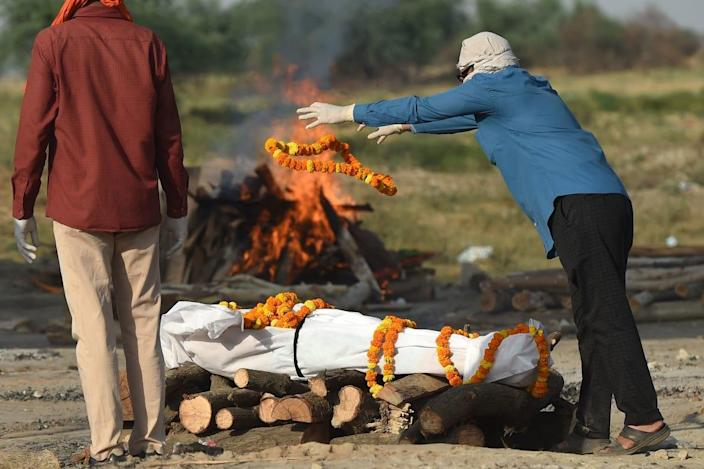 """<div class=""""inline-image__caption""""><p>Relatives perform the last rites before a cremation in Allahabad.</p></div> <div class=""""inline-image__credit"""">Sanjay Kanojia/AFP via Getty</div>"""