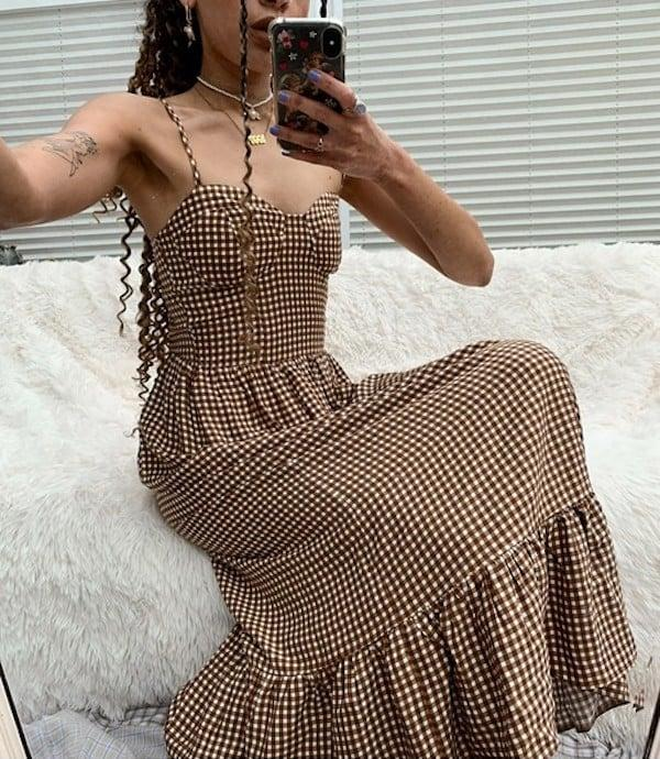 """<p>For those hot September days when you still yearn to wear an autumnal color palette, this <product href=""""https://www.asos.com/us/collusion/collusion-shired-cami-midi-dress-in-brown-gingham/prd/21125243?colourwayid=60142251&amp;SearchQuery=&amp;cid=27108"""" target=""""_blank"""" class=""""ga-track"""" data-ga-category=""""internal click"""" data-ga-label=""""https://www.asos.com/us/collusion/collusion-shired-cami-midi-dress-in-brown-gingham/prd/21125243?colourwayid=60142251&amp;SearchQuery=&amp;cid=27108"""" data-ga-action=""""body text link"""">Collusion Gingham Midi Dress</product> ($35) is the perfect pick. Once it gets chillier, you can layer a beige shirt under it, or throw on a denim jacket over it.</p>"""