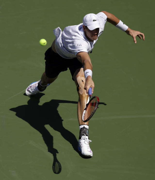 John Isner, of the United States, returns a shot against Jan-Lennard Struff, of Germany , during the second round of the 2014 U.S. Open tennis tournament, Thursday, Aug. 28, 2014, in New York. (AP Photo/Frank Franklin II)