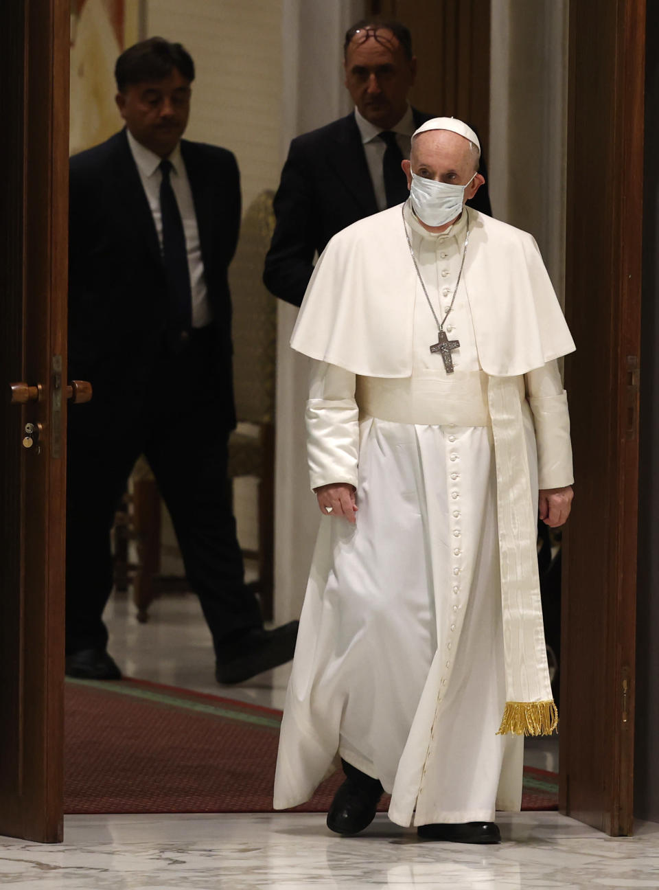 Pope Francis arrives to attend his weekly general audience in the Paul VI hall at the Vatican, Wednesday, Aug. 4, 2021. It was Francis' first general audience since undergoing planned surgery to remove half his colon for a severe narrowing of his large intestine on July 4, his first major surgery since he became pope in 2013. (AP Photo/Riccardo De Luca)