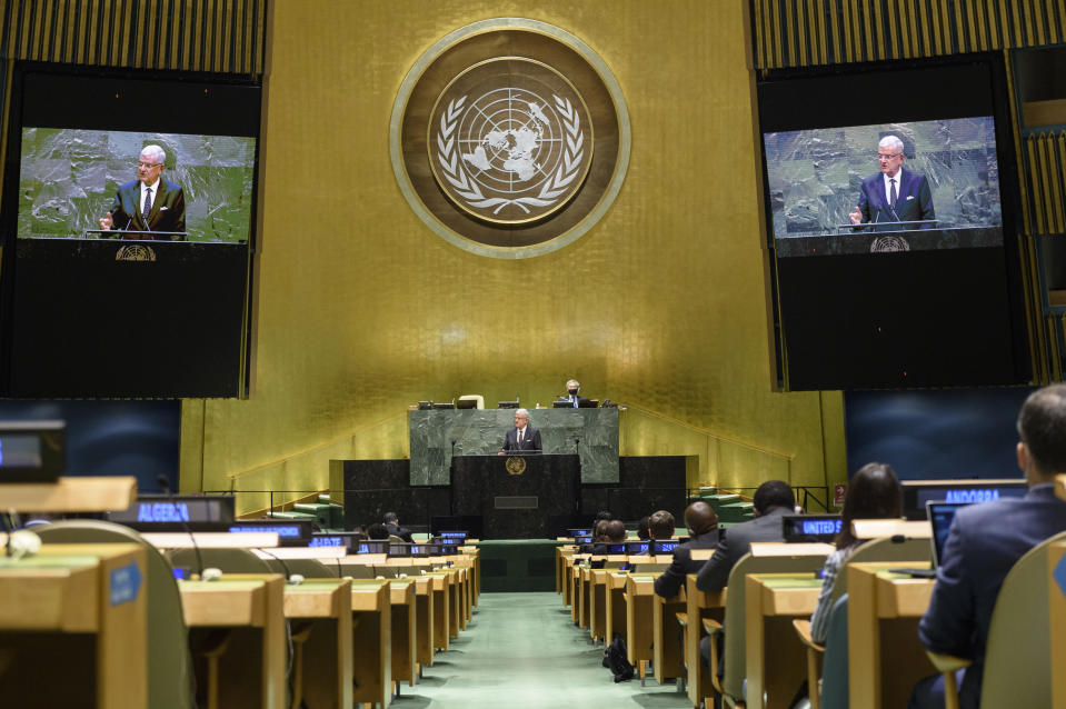 In this UN Photo, Volkan Bozkir, President of the 75th session of the United Nations General Assembly, is shown on video monitors as he makes closing remarks, Tuesday, Sept. 29, 2020, at U.N. headquarters. (Loey Felipe/UN Photo via AP)