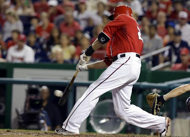 Washington Nationals' Jayson Werth (28) hits an RBI double to score the winning run during the eighth inning of a baseball game against the New York Mets at Nationals Park, Sunday, Sept. 1, 2013, in Washington. The Nationals won 6-5. (AP Photo/Alex Brandon)