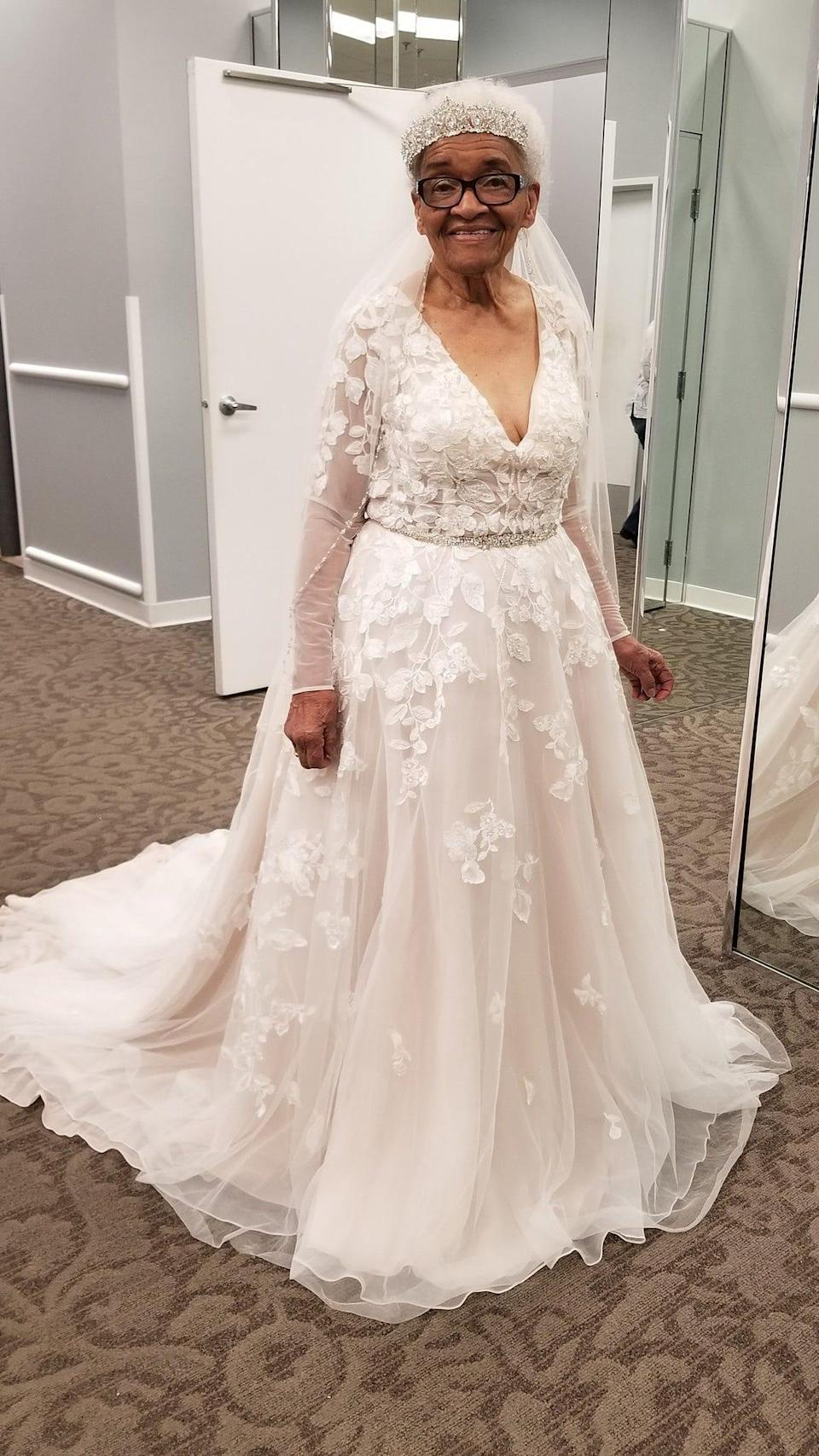 Martha Mae Ophelia Moon Tucker trying on a V neck lace dress at David's Bridal boutique.