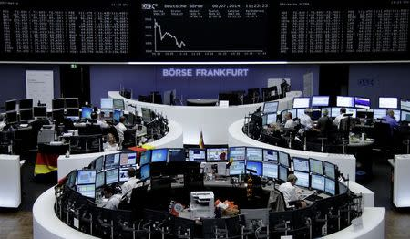 Traders are pictured at their desks in front of the DAX board at the Frankfurt stock exchange July 8, 2014. REUTERS/Remote/Stringer