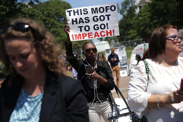 <p>About 300 people rally to protest against President Donald Trump's firing of Federal Bureau of Investigation Director James Comey outside the White House May 10, 2017 in Washington, DC. Angry over the firing of Comey, the demonstrators demanded that an independent special prosecutor investigate possible ties between the Trump campaign and Russian officials. (Chip Somodevilla/Getty Images) </p>