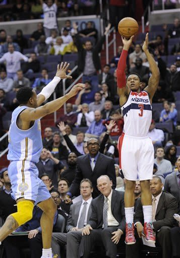 Washington Wizards guard Bradley Beal (3) takes a shot against Denver Nuggets guard Andre Iguodala during the second half of an NBA basketball game, Friday, Feb. 22, 2013, in Washington. The Wizards won 119-113. (AP Photo/Nick Wass)