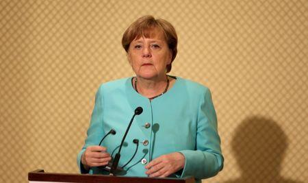 German Chancellor Angela Merkel speaks during a news conference with Tunisia's President Beji Caid Essebsi in Tunis