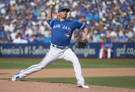 Aug 27, 2016; Toronto, Ontario, CAN; Toronto Blue Jays relief pitcher Roberto Osuna (54) throws a pitch during the ninth inning in a game against the Minnesota Twins at Rogers Centre. The Toronto Blue Jays won 8-7. Mandatory Credit: Nick Turchiaro-USA TODAY Sports / Reuters Picture Supplied by Action Images