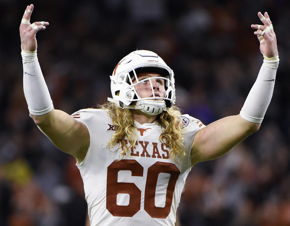 Hager won't cut his hair until the Longhorns win another Big 12 title, a feat not accomplished since 2009. (AP)
