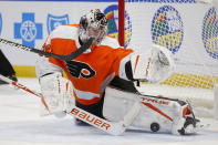 Philadelphia Flyers goalie Carter Hart (79) makes a pad save during the second period of an NHL hockey game against the Buffalo Sabres, Sunday, Feb. 28, 2021, in Buffalo, N.Y. (AP Photo/Jeffrey T. Barnes)